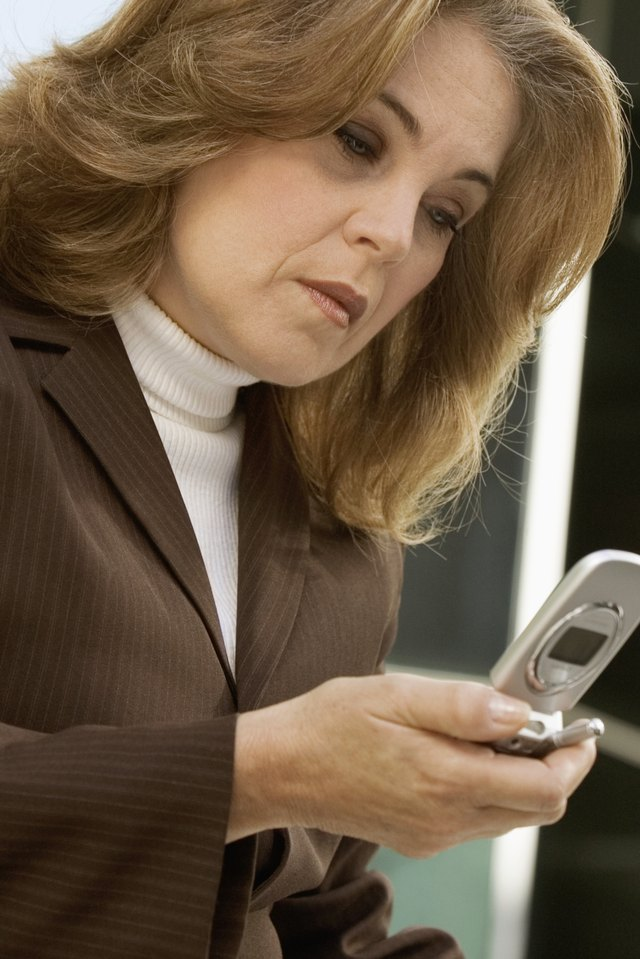 Close-up of a mature businesswoman holding a mobile phone