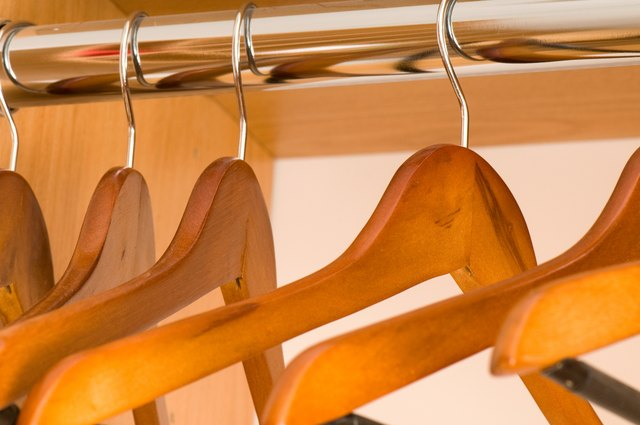 Wooden hangers on rod
