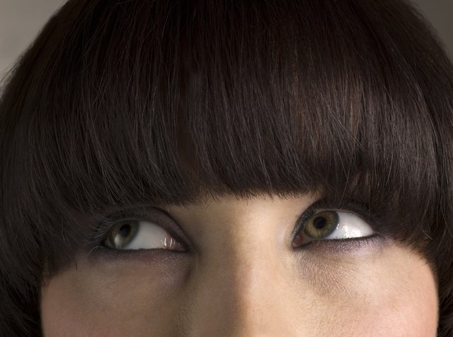Woman with bangs looking away