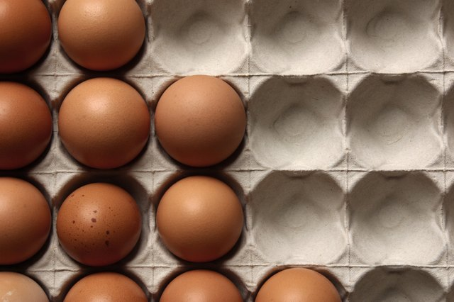 Brown eggs in gray carton
