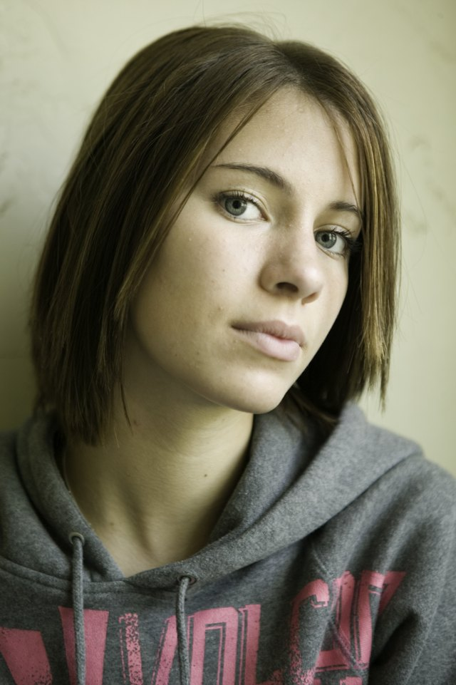 Young woman posing indoors, close-up, portrait