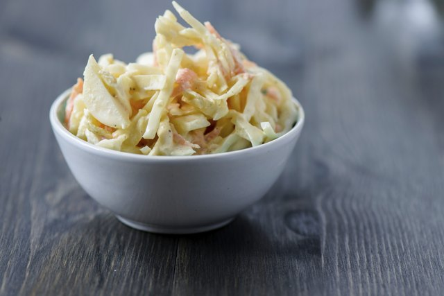 Coleslaw in a bowl on  wooden table