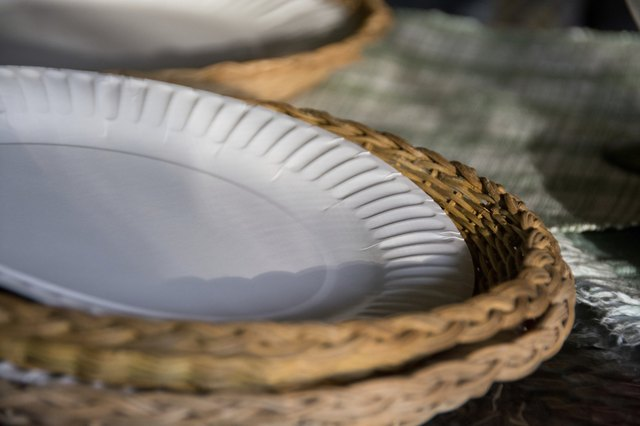 Paper plates in wicker baskets at an evening picnic