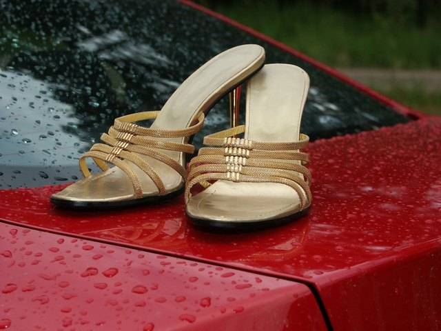 woman shoes on car after rain