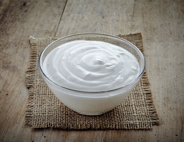 bowl of sour cream on old wooden table