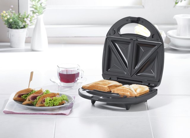 Sandwich maker machine in kitchen interior