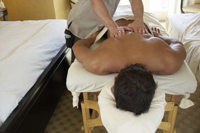 Young man receiving back massage