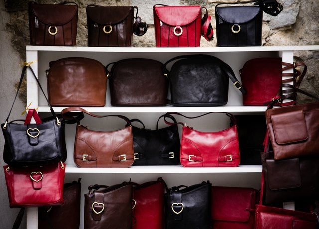 Purses on shelves indoors