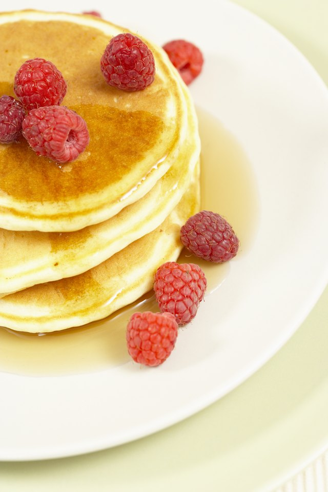 Plate of pancakes with fresh fruit