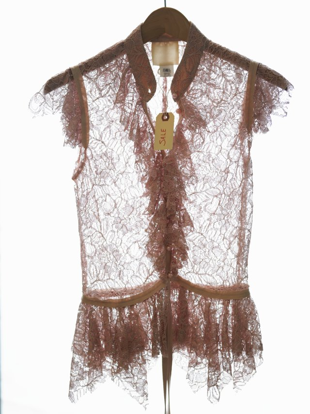 Lace blouse on hanger