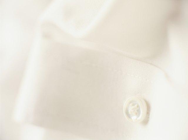 Button of white shirt