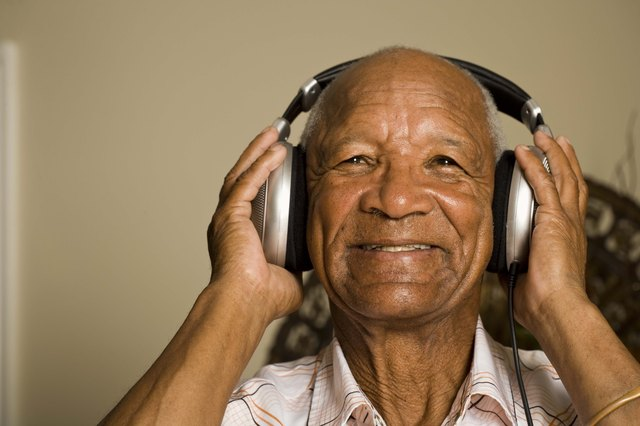 Senior man listening to headphones