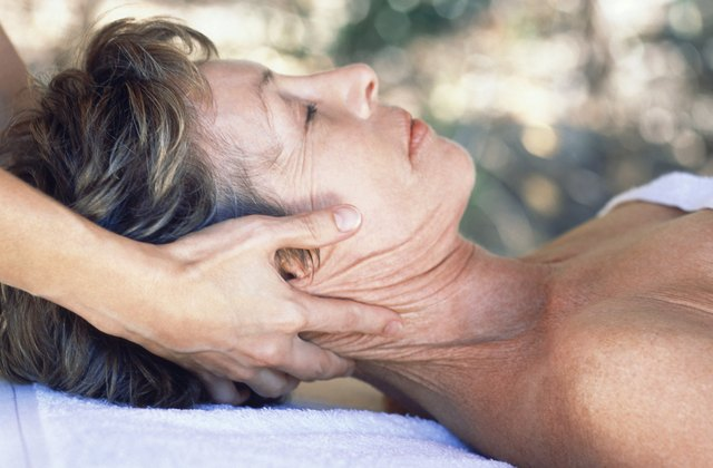 Woman receiving massage outdoors