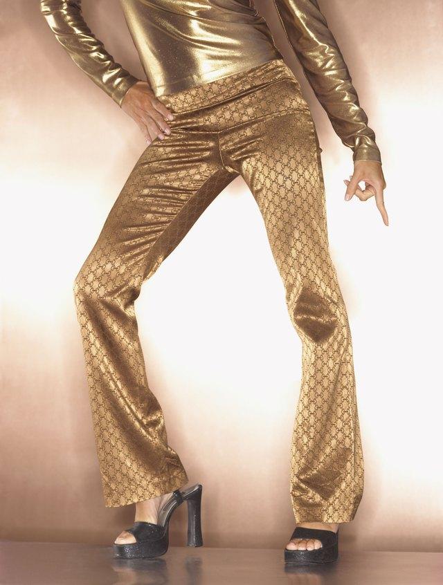 Hip woman in gold disco dancing