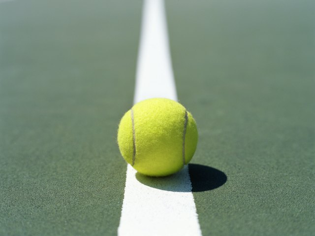 close-up of a tennis ball on the dividing line