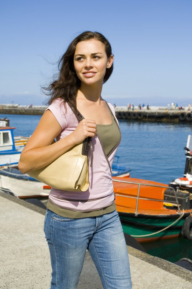 Woman carrying purse on dock