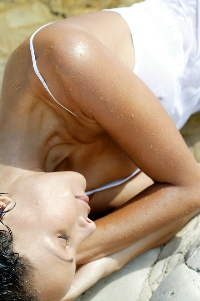 Wet woman sleeping outdoors