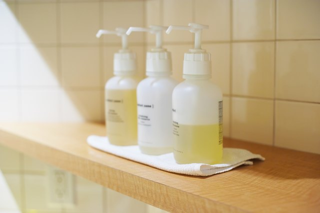 Three dispensers with massage oils at spa
