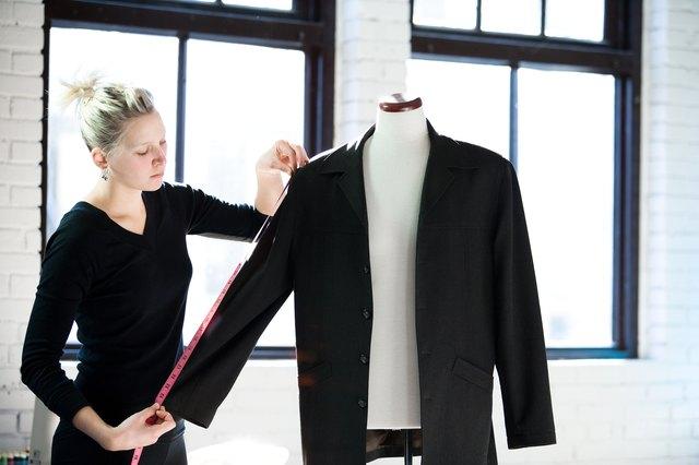 Seamstress measuring sleeve of jacket
