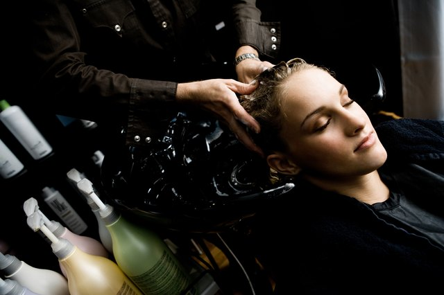 Woman getting her hair washed at a salon