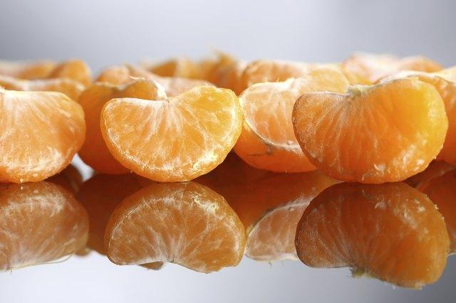 Ripe sweet tangerine slices, close-up