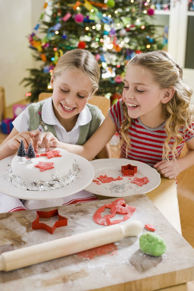 Girls decorating Christmas cake