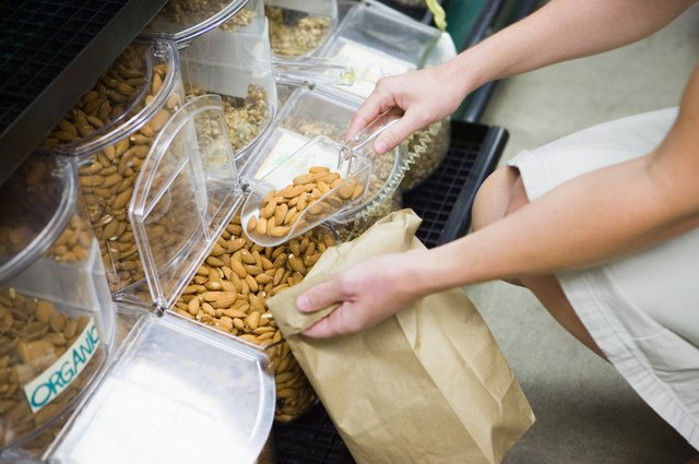 Person filling bag with organic nuts