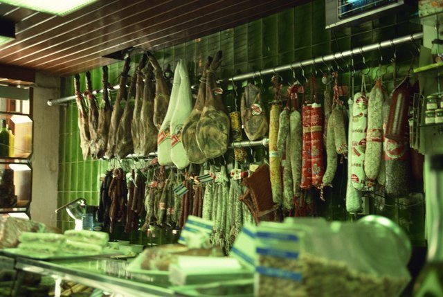 Cured meats hanging in deli