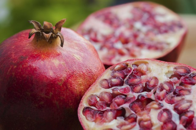 Pomegranates whole and halved
