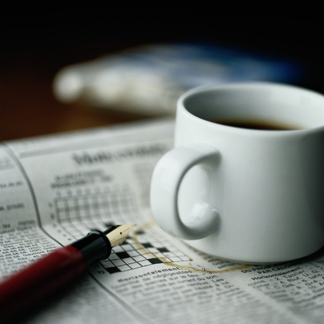 Cup of Coffee, Fountain Pen and Crossword Puzzle
