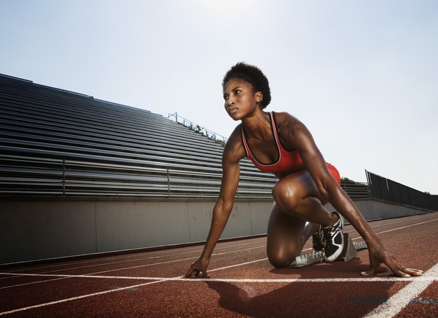Athletic woman preparing for race