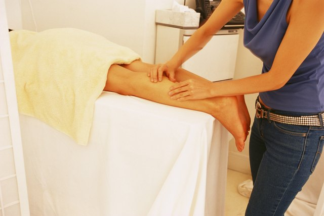 Woman getting legs massaged