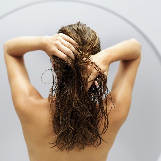 rear view of a woman holding her wet hair