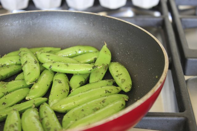 Snow Peas Sauteing in a Frying Pan