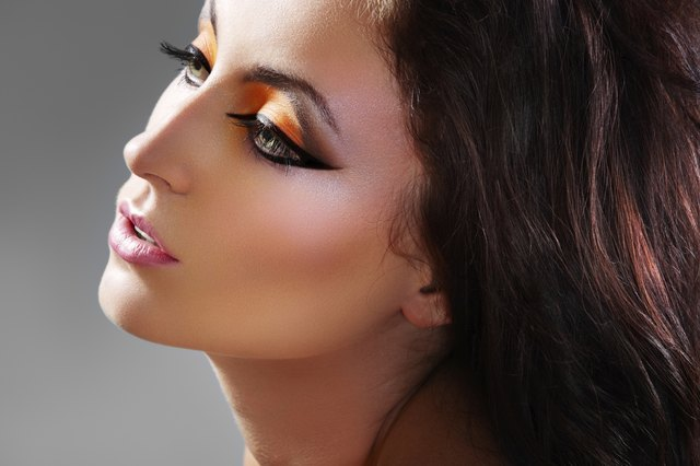 Beautiful woman model with luxury oriental make-up
