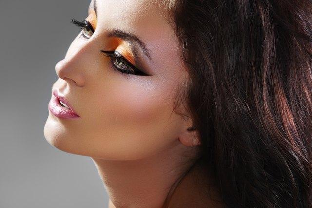 Beautiful woman model with luxury oriental make-up
