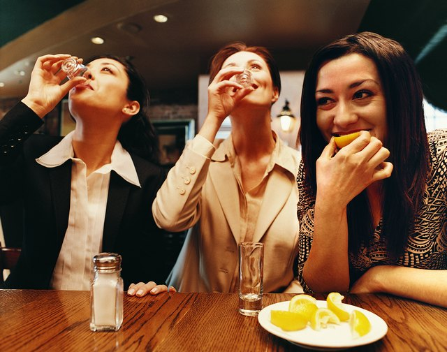 Businesswomen Drinking Tequila in a Bar