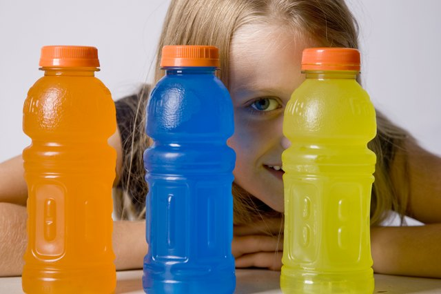 Young Girl Chooses Sports Drink