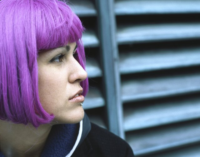 Profile of woman with purple hair