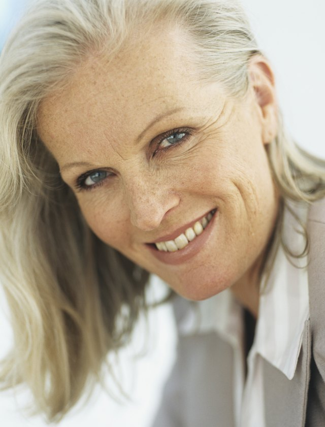 Mature woman smiling,portrait,close-up