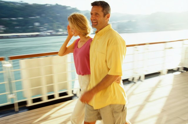 Couple Walks on Deck of Ship