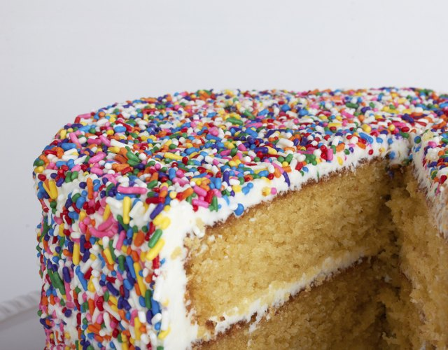 Sliced layer cake with sprinkles