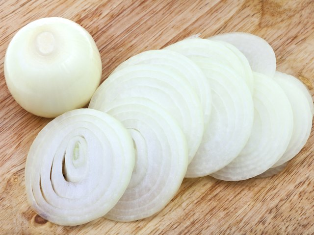 bulb and sliced onions on wooden board