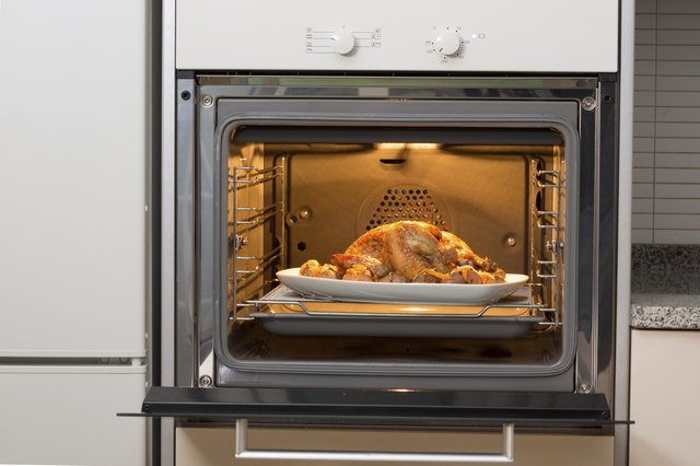 entire chicken being cooked in oven
