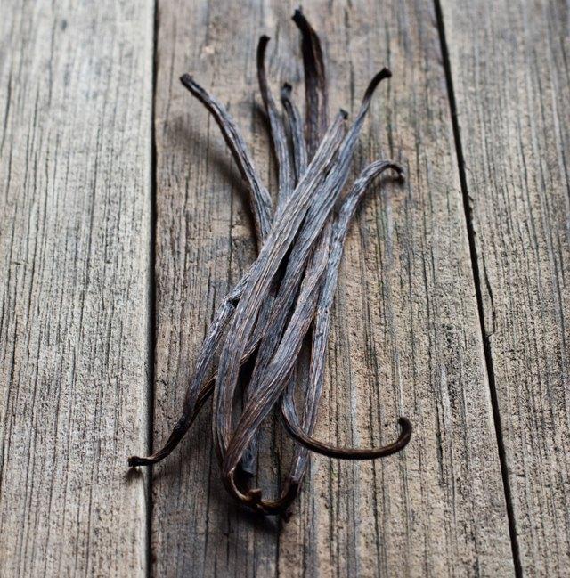 Vanilla sticks on the wood background
