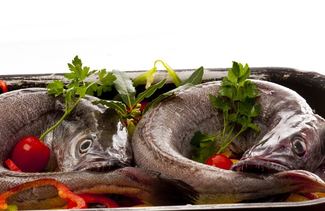 Young hake ready for cooking with  vegetables and herbs.
