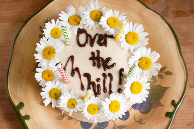 Choose A Humorous Birthday Phrase To Make The Person Smile Over Hill And Still Kicking Nifty At Fifty Catchy Phrases Write On Cake