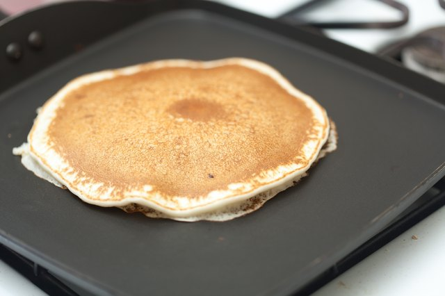 How to cook pancakes with pancake mix leaftv cook until the bottom is golden brown and then flip cook that side until it is golden brown and remove from the griddle serve with syrup and room ccuart Images