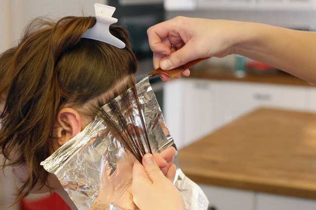 How to dye peek a boo hair leaftv slide hair foil underneath each section of hair paint the hair with the bleach or hair dye with a tinting brush fold the sides of the foil towards the solutioingenieria Image collections