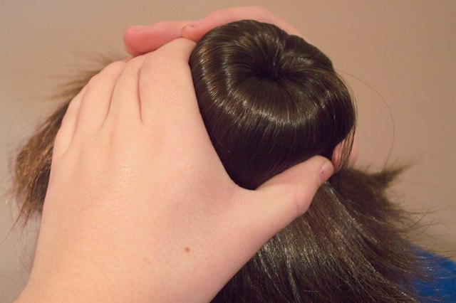 Pull Sections Of Your Hair Around The Donut And Pin Into Place Underneath Through Base Ponytail This Usually Requires Fanning In One